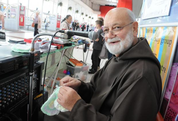 Priest who travels 80 miles to knit and sing in bus station appeals for more wool